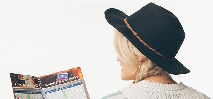 Woman reading Abenity Perks Comparison Report